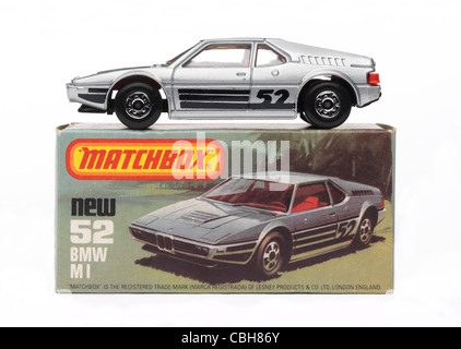 A view of a toy car from the late 70's and early 80's from side on and on white - Stock Photo