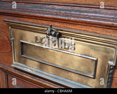 OHMS Crown crested official brass letter box on Government building door in central London UK - Stock Photo
