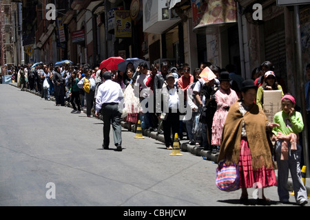 People waiting in line at a bus stop in La Paz, Bolivia - Stock Photo