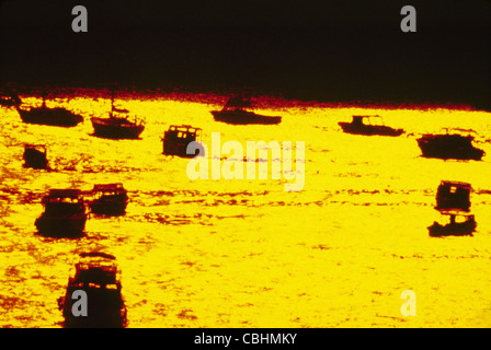 Sailboats and power boats anchored in Zihuatanejo Bay at sunset, Zihuatanejo, c, Mexico - Stock Photo