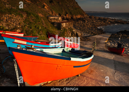 Small boats at Priest's Cove, West Cornwall in evening light. - Stock Photo