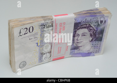 Bank wrapped bundle of one thousand pounds in twenty pound notes. - Stock Photo