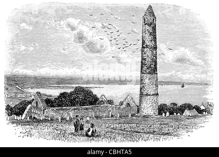 Ardmore tower church monastery Seaside resort fishing village Christian settlement Irish round towers bell house - Stock Photo