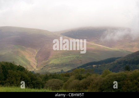 rolling hills england english country side lakes district lake weather cloud clouds in the hill landscape mist over - Stock Photo