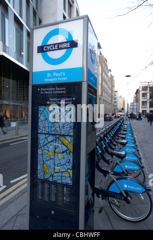 st pauls barclays cycle hire docking station in the city of london england united kingdom uk - Stock Photo