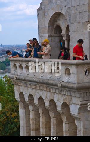 Young people at viewing platform of Halaszbastya the Fisherman's Bastion in Varhegy the Buda Castle Hill Budapest - Stock Photo
