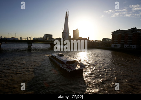 thames clipper on the river thames early morning london england united kingdom uk - Stock Photo