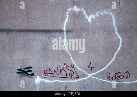 ' Love Plane' New Banksy artwork, the defaced painting believed to be by the street artist Banksy has appeared in - Stock Photo