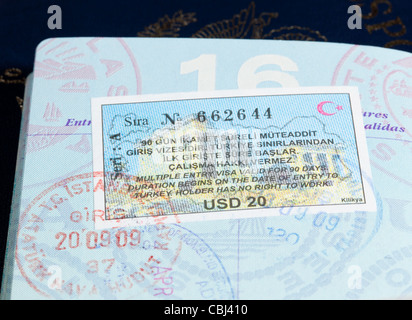 Macro image of visa and immigration stamps in US passport for Istanbul Turkey - Stock Photo