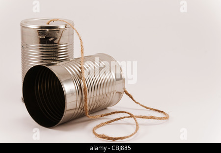 A pair of tin cans on a string used by kids to talk back and forth. - Stock Photo