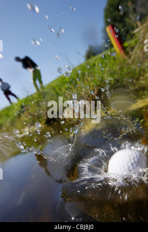 Two men playing golf, Prien am Chiemsee, Bavaria, Germany - Stock Photo