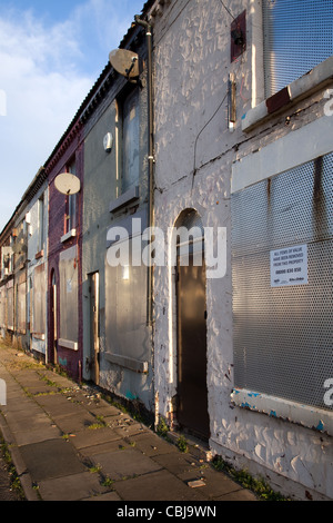 All Items of Value. Rundown Boarded Up, sealed and Empty Terraced Property, house, terrace, architecture, home, - Stock Photo