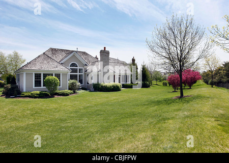 Rear view of suburban home with large back yard - Stock Photo