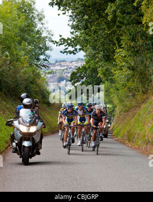 Tour of Britain cyclists racing through the Devon lanes near Crediton. On the right Jonathon Tiernan Locke - Stock Photo