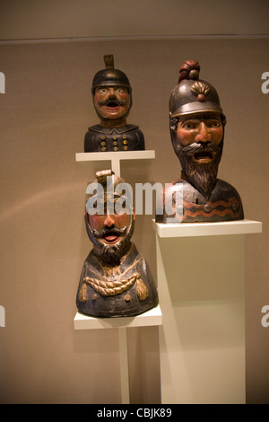 Gaper heads traditionally used to identify a pharmacy in Holland, Zuiderzee museum, Enkhuizen, Netherlands - Stock Photo