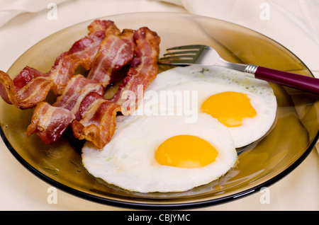 Fried Eggs and Bacon - Stock Photo