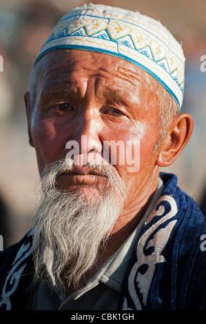portrait of an old Kazakh man the Altai Region of Bayan-Ölgii in Western Mongolia - Stock Photo