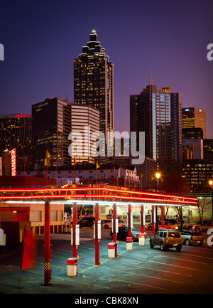 Midtown Atlanta buildings at dusk with a drive-in fast food restaurant in the foreground - Stock Photo