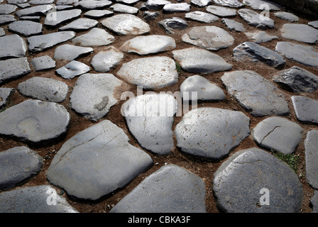 Ancient cobblestones at the Colosseum in Rome. - Stock Photo