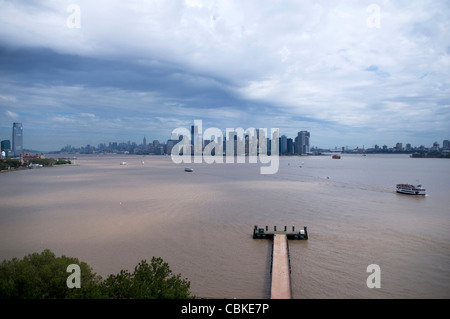 Aerial panorama view from Statue of Liberty Observation Level of Upper New York Harbor on cloudy day after storm - Stock Photo