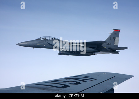 U.S. Air Force McDonnell Douglas F-15E Strike Eagle over the wing of a Boeing KC-135 Stratotanker. - Stock Photo