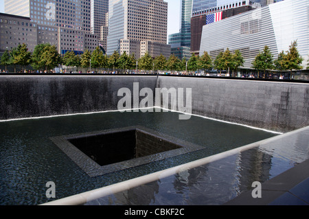 World Trade Center Memorial in memory to those who perished in the terrorist attack on September 11, 2011 in NYC - Stock Photo