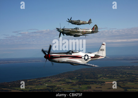 Angelholm, Sweden - North American P-51 Cavalier Mustang with Supermarine Spitfire Mk. XVIII and Mk. XVI fighter - Stock Photo