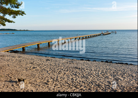 Bathing bridge in the Baltic sea - Stock Photo