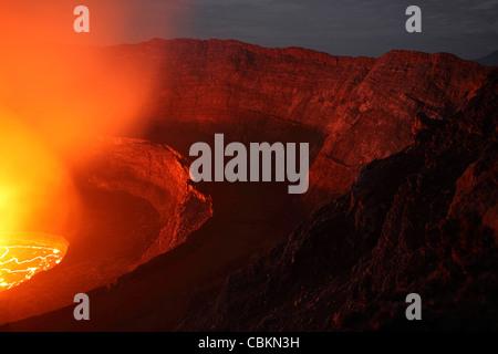 January 21, 2011 - Nighttime view of summit caldera with lava lake, Nyiragongo Volcano, Democratic Republic Congo. - Stock Photo