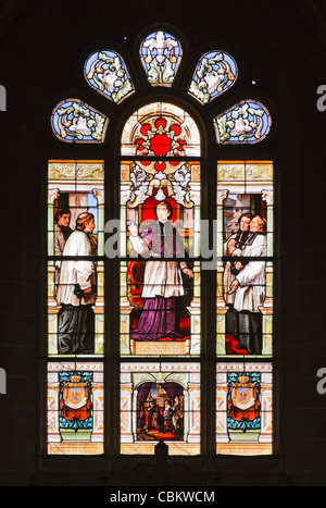 Stained glass window in the Basilica at St Anne dAuray, Morbihan, Brittany, France - Stock Photo