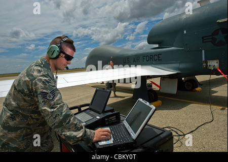 Staff Sgt. Ryan Conversi, a dedicated crew chief for the RQ-4 Global Hawk, prepares the unmanned aircraft system - Stock Photo