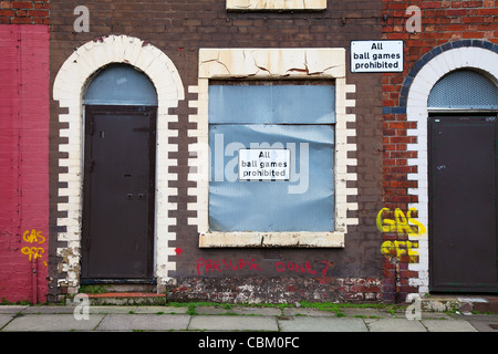 'All Ball Games Prohibited' Two-up two-down Boarded Up house and sealed empty Terraced Property in Anfield, Liverpool - Stock Photo