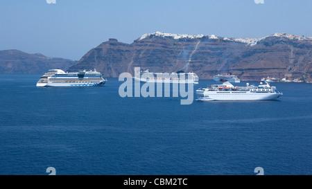 a view from a cruiseship on Santorini Greecewith cruiseships - Stock Photo