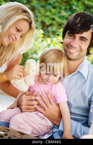 young family  in their garden - Stock Photo