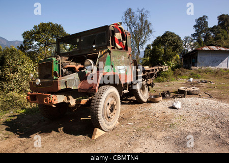 India, Arunachal Pradesh, Rotung, old truck in pieces being repaired at side of road - Stock Photo