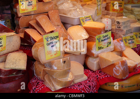 Cheese on sale on a Dutch market stall in Amsterdam in the Netherlands - Stock Photo