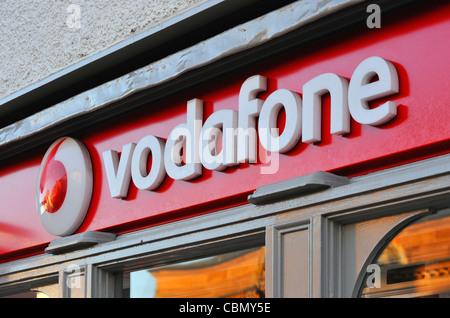 Vodafone store logo. Stricklandgate, Kendal, Cumbria, England, United Kingdom, Europe. - Stock Photo