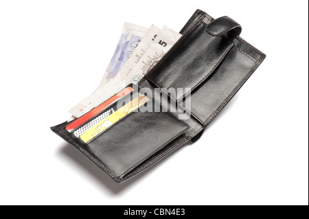 A leather wallet containing British bank notes and cards - Stock Photo