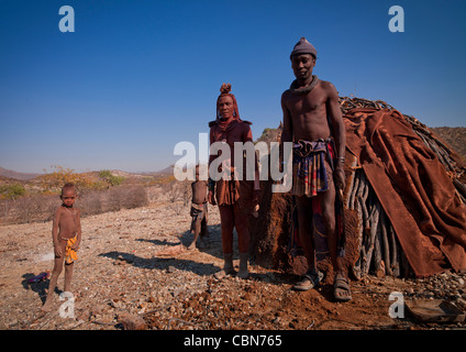 Himba Family In Front Of Their Hut, Angola - Stock Photo