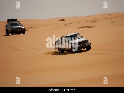 Tourists Doing A Safari Tour In Four Wheel Drives In The Namib Desert, Iona National Park, Angola - Stock Photo