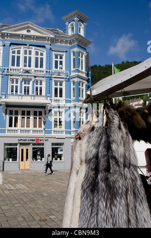 Norway, Bergen. Historic downtown. Fox fur pelts hanging in front of historic home. - Stock Photo
