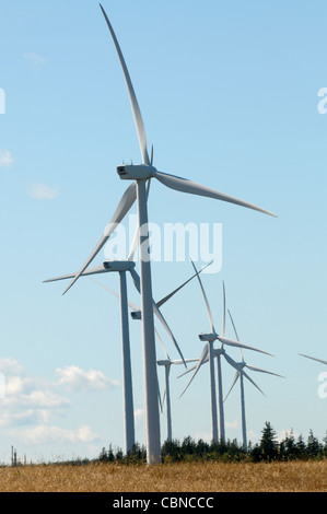 Commercial windmills are lined up grabbing the wind for electric power on Prince Edward Island, Canada. - Stock Photo