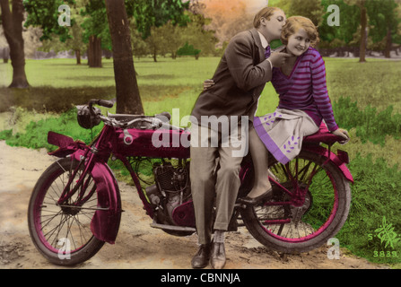 Couple kissing on dirt road against bright sun Stock Photo ...