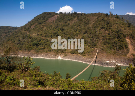 India, Arunachal Pradesh, Kabang, man crossing suspension bridge across Siang, River in foothills of Himalayas - Stock Photo