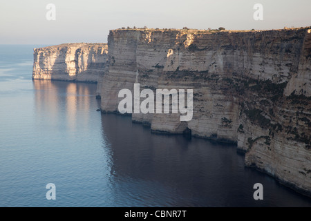 The seacliff at Ta Cenc in Gozo falls dramatically into the deep sea in a dramatic clear-cut shear that is 100 metres - Stock Photo