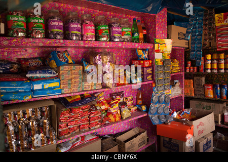 India, Manipur, Lairouching Hills, shelves of small shop in small local bazaar - Stock Photo
