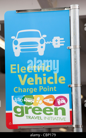 An electric car charging point provided free of charge in a Tesco Supermarket car park for their customers, near - Stock Photo