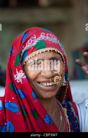 Elderly Indian woman at home in Narlai village in Rajasthan, Northern India - Stock Photo