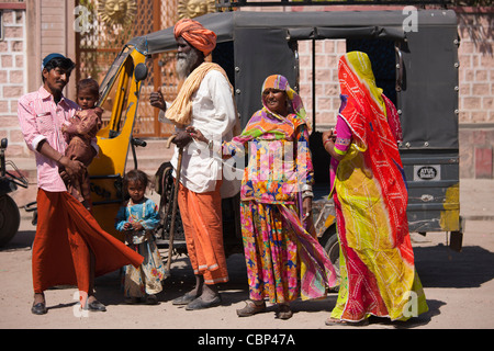 Indian family three generations with pregnant young wife by auto rickshaw in Sadri town of Rajasthan, Western India - Stock Photo