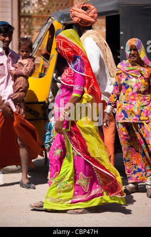 Young pregnant Indian woman, discreetly veiled, with her family in Sadri town in Pali District of Rajasthan, Western - Stock Photo